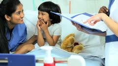 Little Ethnic Girl Hospital Patient Multi Ethnic Nurses - stock footage