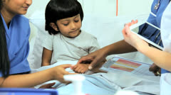 Specialist Nursing Staff Recording Child Care Tablet Stock Footage