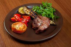 Grilled beef on white plate  with vegetable. Stock Photos