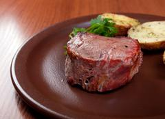grilled beef on white plate with potatoes - stock photo
