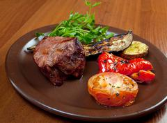 grilled beef on white plate  with vegetable. - stock photo