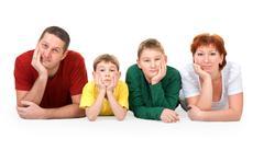 Family of four on the floor Stock Photos
