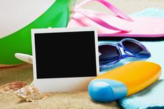 Photoframe and beach gear Stock Photos
