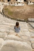 Girl in the amphitheater Stock Photos