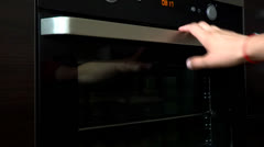 Person open oven cooking Stock Footage