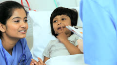 Specialist Nursing Staff Treating Child Patient Stock Footage