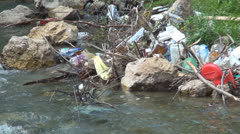 Mountain River Pollution, Garbage in Running Water, Polluted with Trash  - stock footage