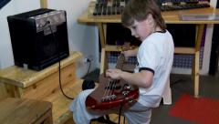 "Boy with electric guitar. Moscow Museum of Science ""Experimentanium"". Stock Footage"