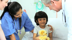 Stock Video Footage of Little Ethnic Child Patient Paediatric Doctor Nurse Care