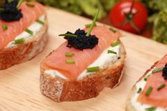 fingerfood with smoked salmon - stock photo