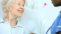 Ethnic Cardiology Nurse Treating Senior Patient - stock footage
