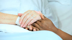 Close Up Hands Ethnic Nurse Caucasian Patient Hospital Bed Stock Footage