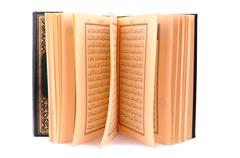 The holy book of quran isolated on white Stock Photos