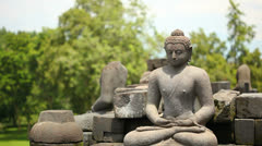 Buddha in the lotus position Stock Footage