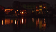 Water residence with light reflection 2ext, night Stock Footage