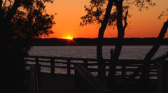 Waterway sunset over walkway zoomed, Static 12fps @ 50% Stock Footage