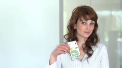 Young women five euro bill Stock Footage