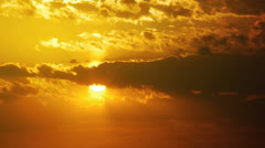 Sun and clouds sunset timelapse Stock Footage