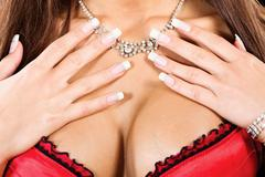 Woman's breasts and neck with a necklace Stock Photos