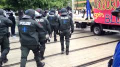 Occupy Frankfurt demonstration police flashing blue light Stock Footage