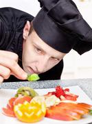 chef decorating delicious fruit plate - stock photo