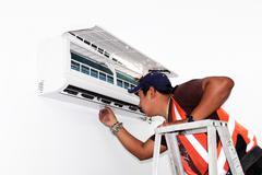 Air conditioning repair Stock Photos