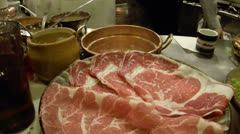Thinly sliced meat for Japanese shabu-shabu (stew) Stock Footage