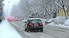 Roads in the town center while heavy snowing Stock Footage
