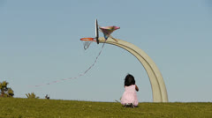Girl with Kite under Basketball Court Stock Footage