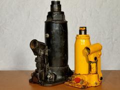 Two old hydraulic bottle jacks. Stock Photos