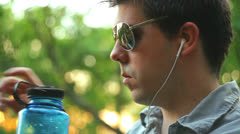 Drinking water hot summer drink 2 sun glasses Stock Footage