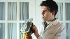 Doctor looking at power tool Stock Footage