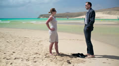 Businesscouple standing on the beach and talking Stock Footage