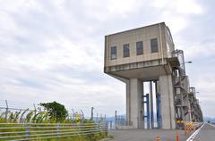 Dam gates along the road between isahaya to obama, japan Stock Photos