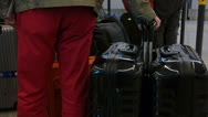 Carrying suitcase at check in lane. Stock Footage