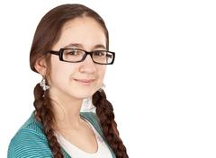 teen girl with pigtails wearing glasses - stock photo
