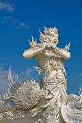 native thai style giant statue in  wat rong khun, chiang rai province, northe - stock photo