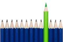 Green crayon standing out from the crowd Stock Photos