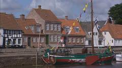 RIBE, DENMARK - boat moored at quay in Ribe harbor Stock Footage