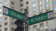 Chicago street sign and modern building, Michigan and Chicago Avenue, Illinois,  - stock footage