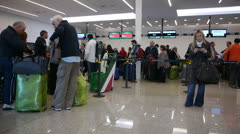Airport terminal day. Passengers check in area Stock Footage
