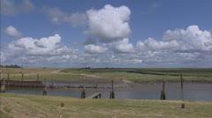 coastal area at harbour pan reclaimed land along Wadden Sea - stock footage