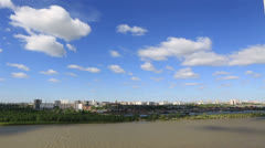 Cumulus clouds floating above the city. timelapse view Stock Footage