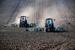 tractors with sowers on the field - stock photo