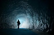Human figure silhouette inside ice cave Stock Photos