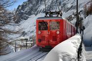 Scenic mountain train in snow Stock Photos