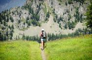 Woman walking, trekking up a mountain Stock Photos