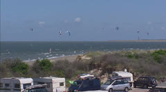 Dutch Delta Works - Kitesurfers along Dutch coast near Brouwers Dam Stock Footage