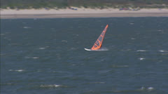 Windsurfer along Dutch coast near Brouwers Dam Stock Footage