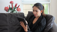 Stock Video Footage of Asian Female Office Worker Talking On Tablet